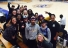 Bellevue University students in a group at basketball game