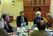 Small group of Wyoming PMO members meet around a table