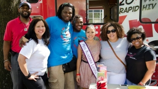 Alabama Latino AIDS Coalition members stand with Miss Alabama Latina