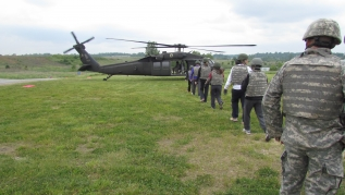 Operation Immersion participants file onto a helicopter